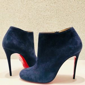 Navy blue suede Christian Louboutin booties.